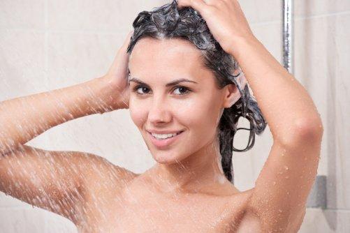 bigstock-Young-woman-washing-head-by-s-37586176-1024x682_501x334